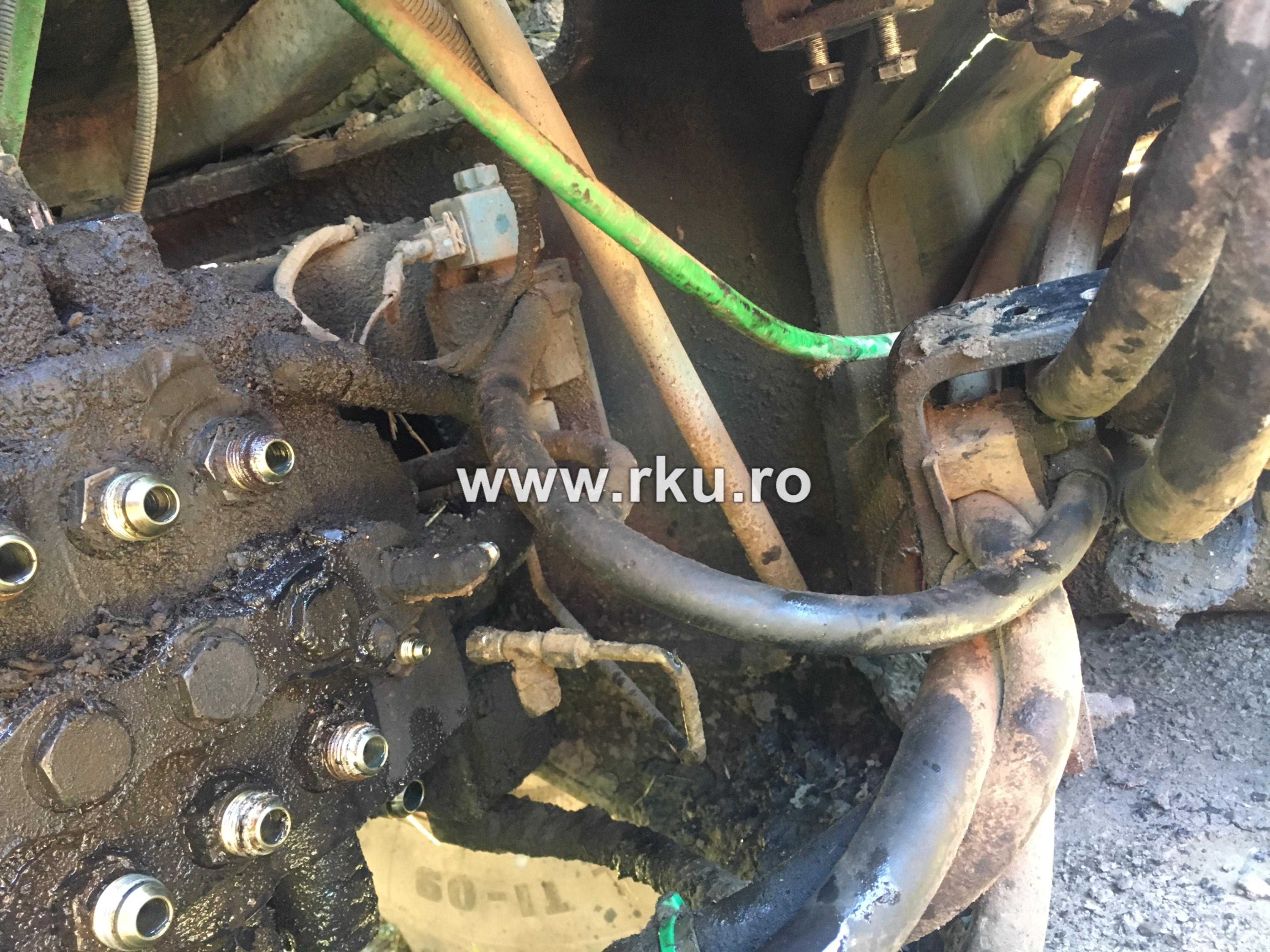 buldoexcavator terex distribuitor sistem hidraulic