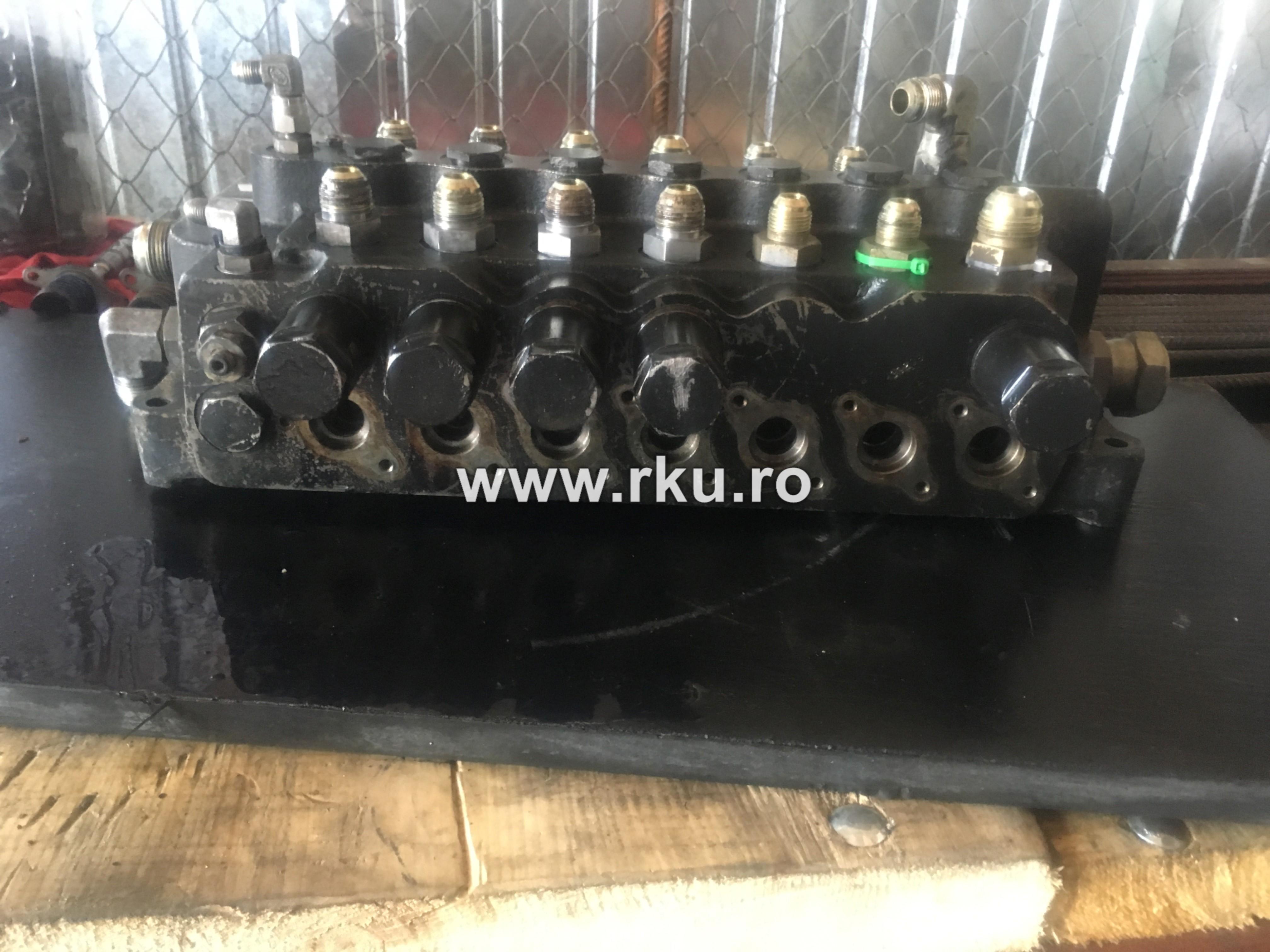 reparatie distribuitor buldoexcavator terex